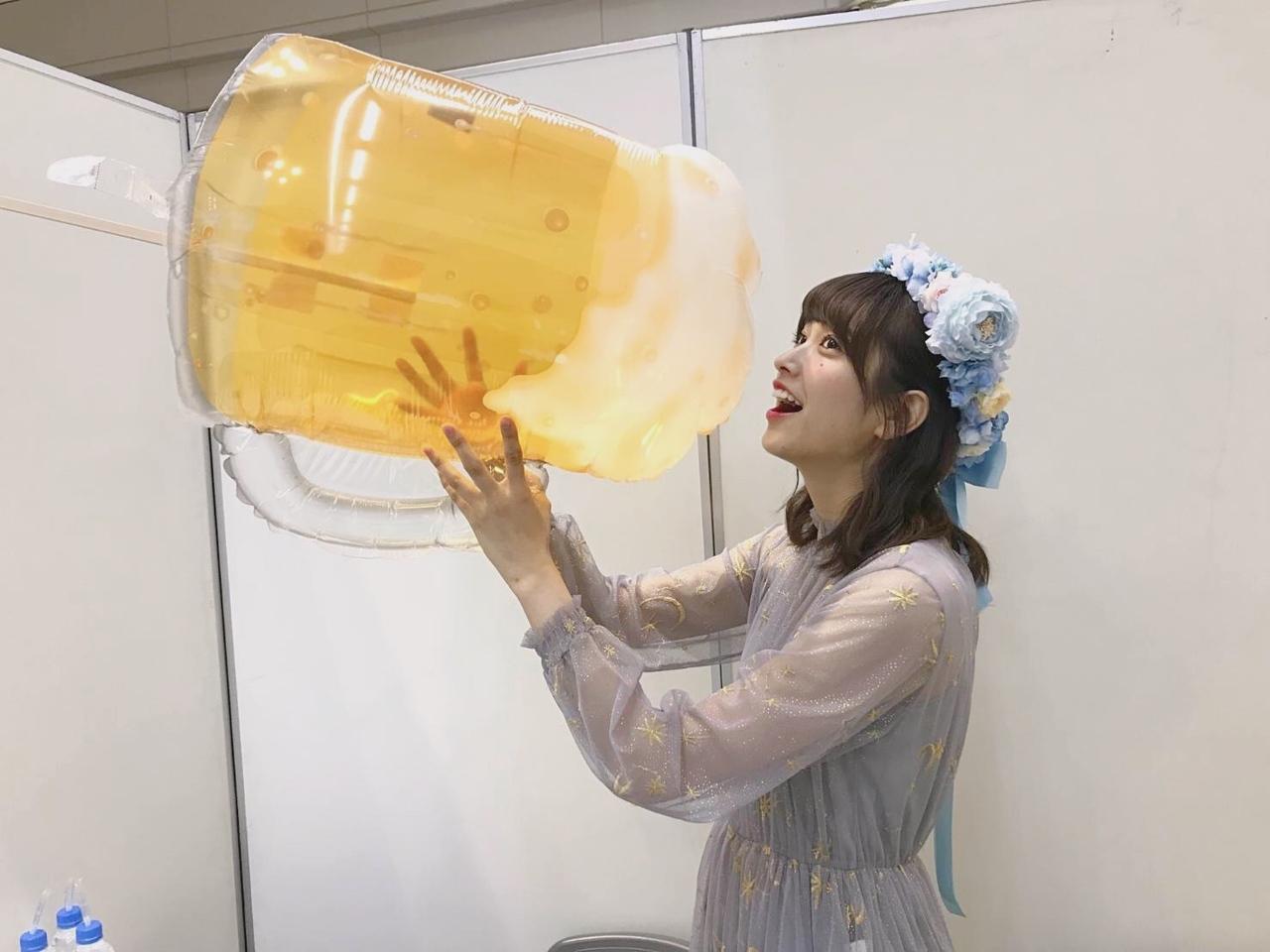 Kumi with a huge inflatable beer jug
